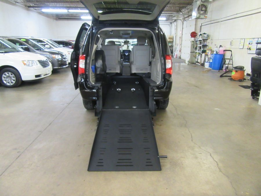 Black Chrysler Town and Country with Rear Entry Manual Fold Out ramp