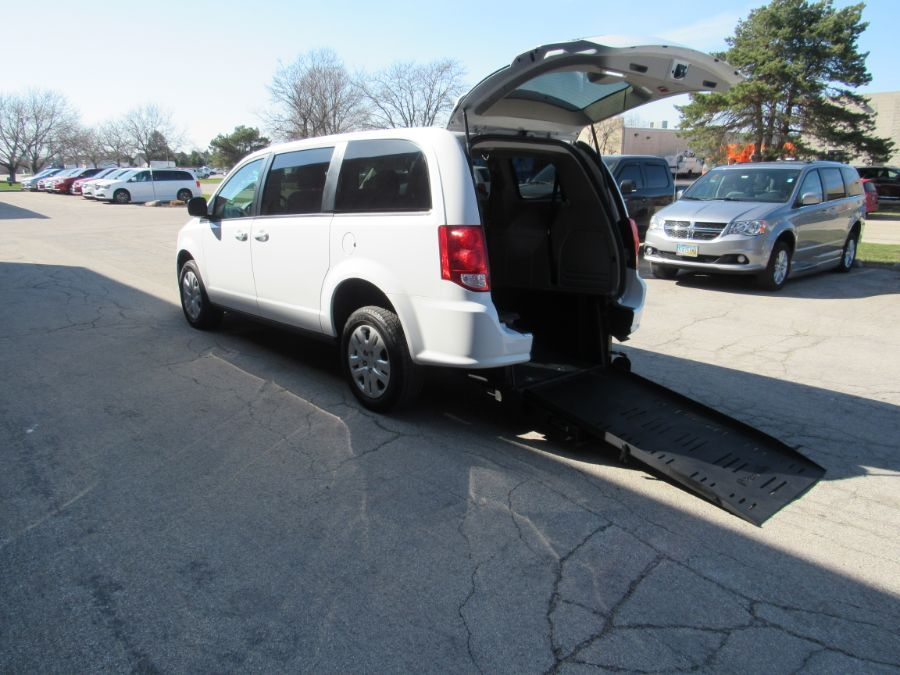 White Dodge Grand Caravan with Rear Entry Manual  ramp