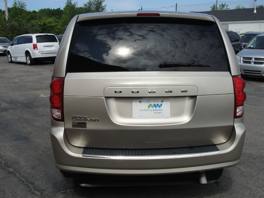 Brown Dodge Grand Caravan image number 6