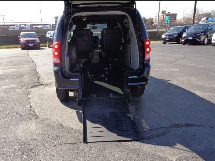 Gray Dodge Grand Caravan with Rear Entry Automatic Fold Out ramp