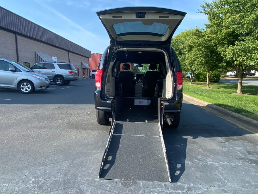 Black Dodge Grand Caravan with Rear Entry Manual Fold Out ramp