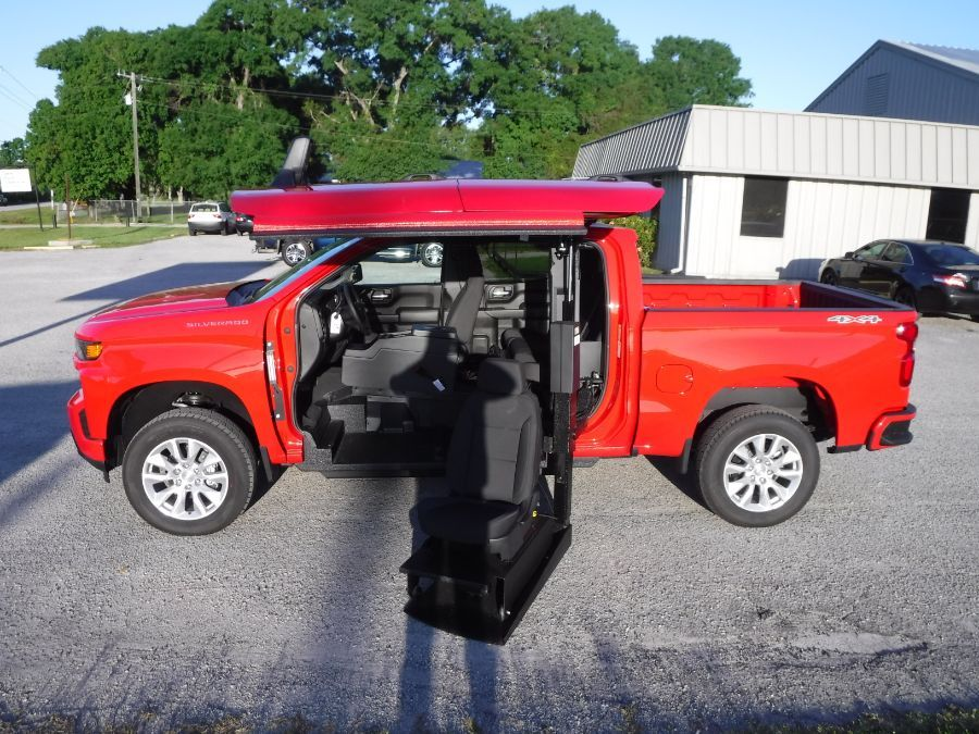 Red Chevrolet Silverado 1500 with Side Entry Automatic In Floor ramp