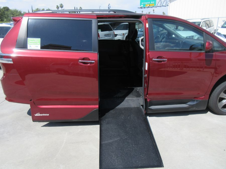 Red Toyota Sienna with  Automatic In Floor ramp