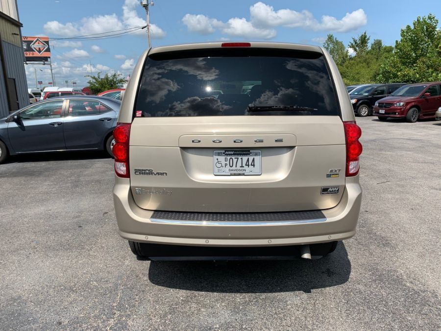 Brown Dodge Grand Caravan image number 4