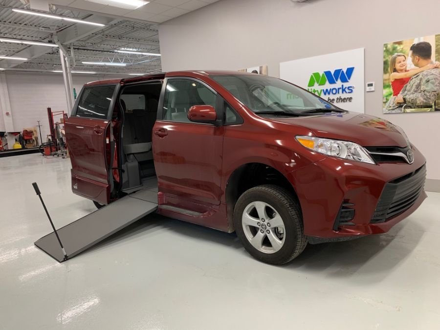 Red Toyota Sienna with Side Entry Manual In Floor ramp