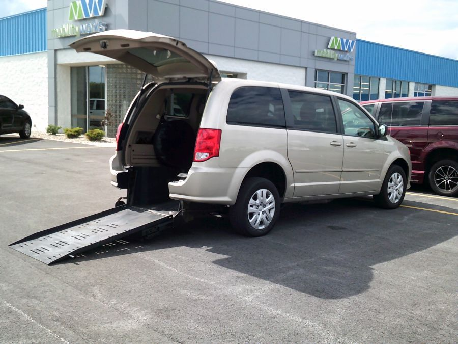 Gold Dodge Grand Caravan with Rear Entry Manual Fold Out ramp