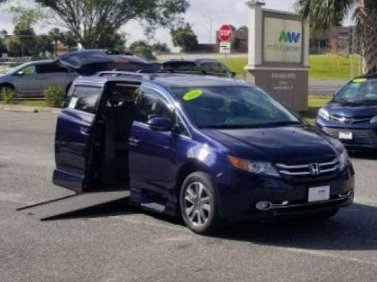 Blue Honda Odyssey with    ramp