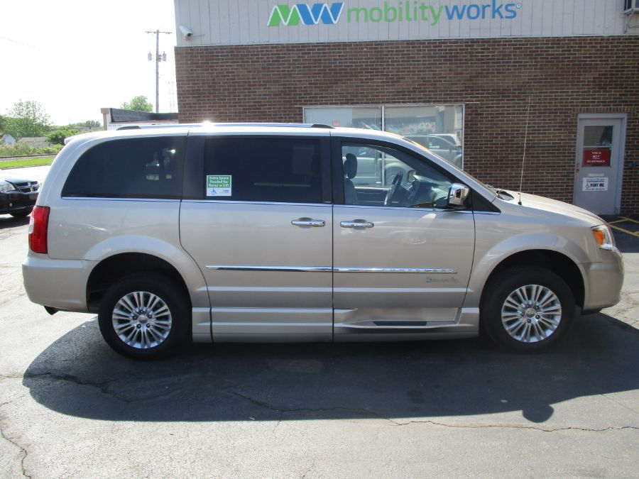 Gold Chrysler Town and Country image number 9