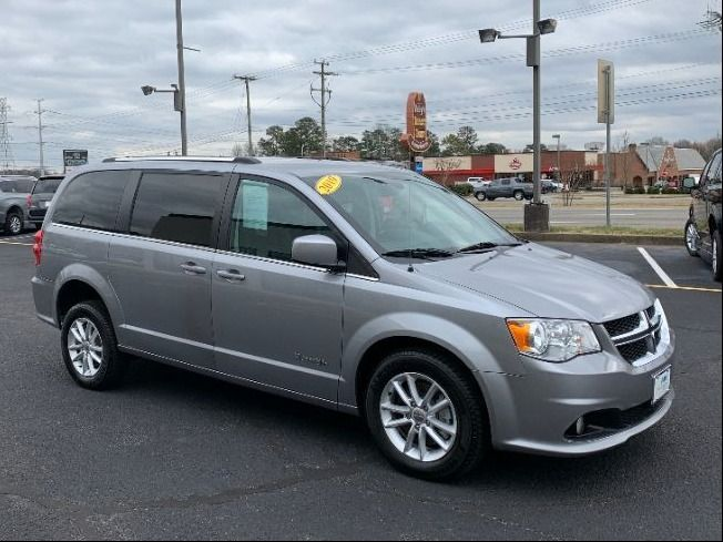 Silver Dodge Grand Caravan with Rear Entry Automatic Fold Out ramp