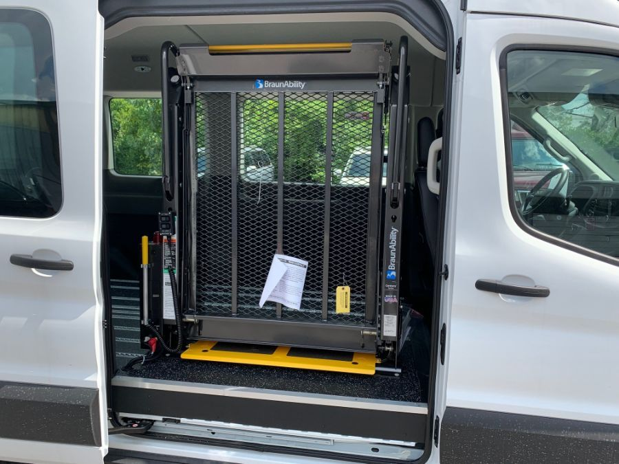 White Ford T350 with Side Entry Automatic Fold Out ramp