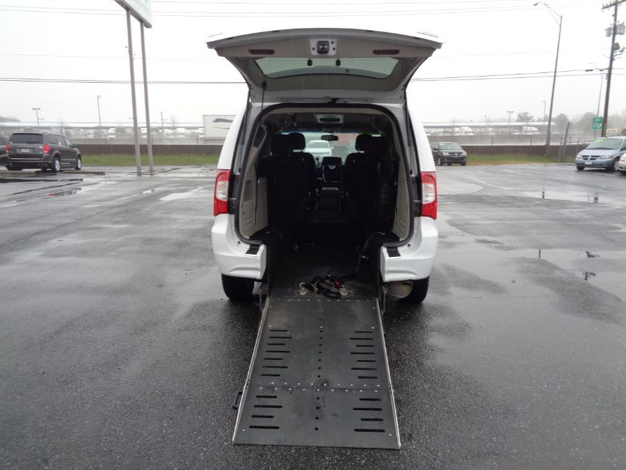 White Chrysler Town and Country with Rear Entry Manual Fold Out ramp