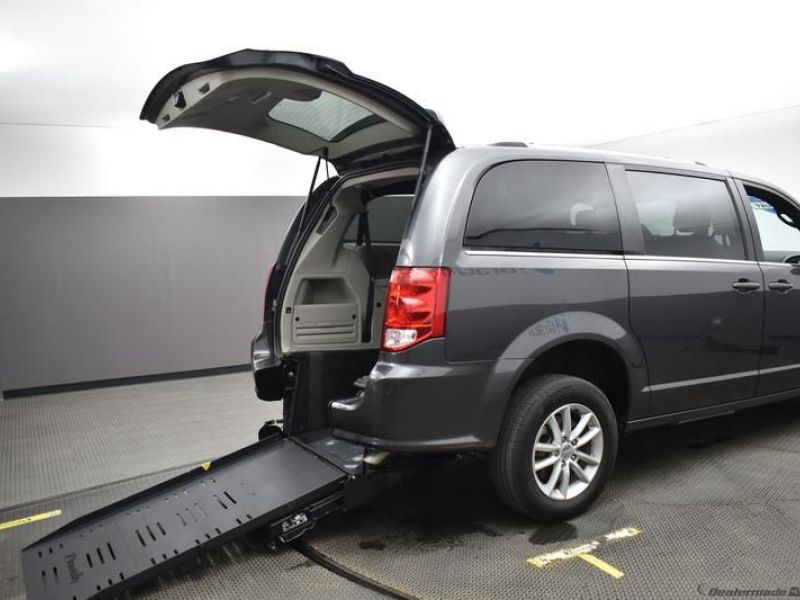 Gray Dodge Grand Caravan with Rear Entry Manual Fold Out ramp