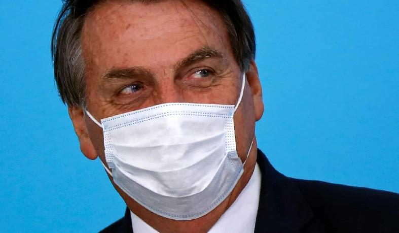 """Bolsonaro afirmou que, desde o início da crise, destacou que tanto o vírus quanto o desemprego """"precisavam ser tratados igualmente"""" e acusou parcela da imprensa brasileira de disseminar o pânico"""