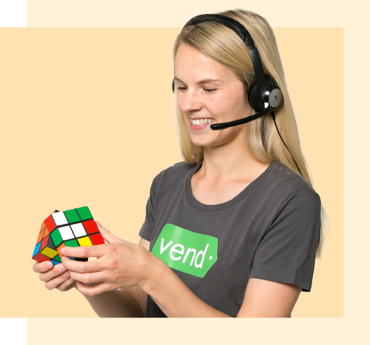 Vend support person holding a rubiks cube