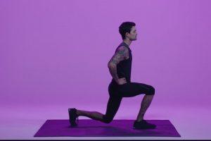 man demonstrating a body leg squat