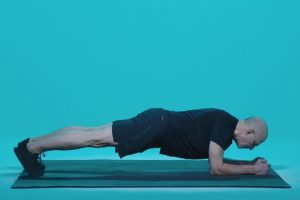 man demonstrating a plank position
