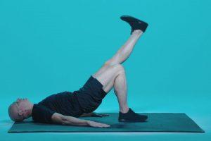 man demonstrating a single leg raise exercise move