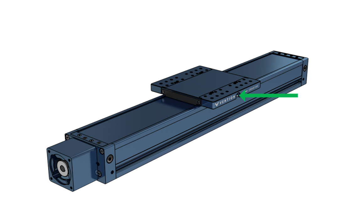 Figure 12: Green arrow points to Zerk fitting located on the gantry. There are fittings on both sides of the gantry.
