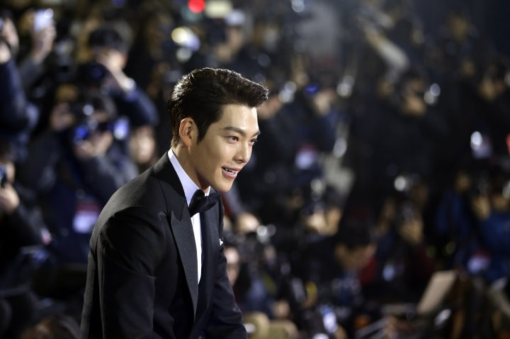 "FILE - In this Friday, Nov. 21, 2014 file photo, South Korean actor Kim Woo-bin arrives for a photo call during the Daejong Film Awards in Seoul, South Korea. Chinese anger at South Korea over its decision to deploy an U.S. anti-missile defense system appears to be threatening everything from appearances by the stars of K-Pop to future cooperation on North Korea at the United Nations. Youku, China's biggest streaming site, cancelled a promotional event with Kim due to what the company called ""forces beyond our control."" (AP Photo/Lee Jin-man, File)"