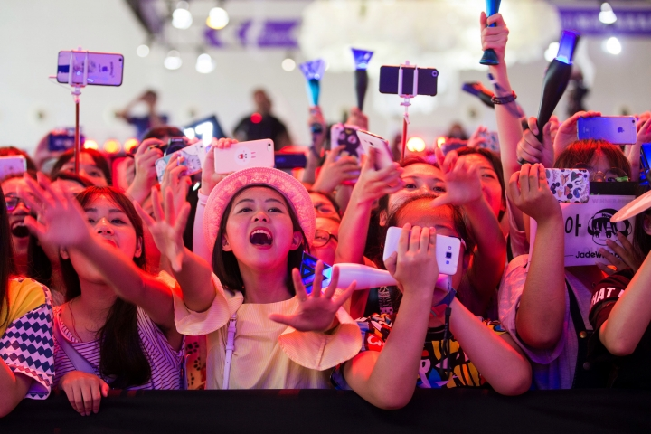In this Friday, July 22, 2016 photo, Chinese fans cheer during a concert by the South Korean K-Pop group Winner in Shanghai. Chinese anger at South Korea over its decision to deploy an U.S. anti-missile defense system appears to be threatening everything from appearances by the stars of K-Pop to future cooperation on North Korea at the United Nations. (Chinatopix via AP)