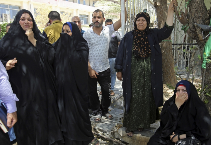 Families of newborn babies who died in a fire gather outside a maternity ward at Yarmouk hospital in western Baghdad, Iraq, Wednesday, Aug. 10, 2016. A fire ripped through the maternity ward at the Baghdad hospital overnight, killing at least 11 newborn babies in a deadly blaze that was likely caused by faulty electrical wiring, an Iraqi spokesman said Wednesday. (AP Photo/Karim Kadim)