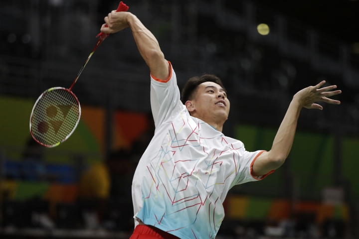 In this Aug. 8, 2016 photo, United States' Howard Shu returns a shot during practice for his badminton matches at the 2016 Summer Olympics in Rio de Janeiro, Brazil. The top-ranked American singles player has his biggest match yet when he opens play Friday, Aug. 12, in a sport known more as a lazy backyard summer game than a serious sport in the Summer Games. (AP Photo/Jae C. Hong)