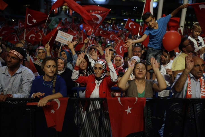 Supporters of Turkish President Recep Tayyip Erdogan dance during an anti coup rally at Taksim square in Istanbul, Wednesday, Aug. 10, 2016. The failed July 15th coup left more than 270 people dead and about 18,000 people have been detained or arrested. (AP Photo/Thanassis Stavrakis)