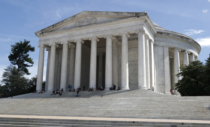 A grimy biofilm is seen along the upper edges and corners of the the Thomas Jefferson Memorial in Washington, Wednesday, Aug. 10, 2016. The Washington Post reports that conservationists are baffled over how to stop a microbial invasion that's been slowly covering the Jefferson Memorial in recent years. It's causing the 73-year-old white neoclassical structure to take on a dingy look. Now Park Service officials are experimenting with several cleaning solutions in hopes of removing the gunk without damaging the marble. (AP Photo/Carolyn Kaster)
