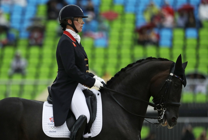 Britain's Fiona Bigwood, riding Orthilia, competes in the equestrian dressage competition at the 2016 Summer Olympics in Rio de Janeiro, Brazil, Wednesday, Aug. 10, 2016. (AP Photo/John Locher)