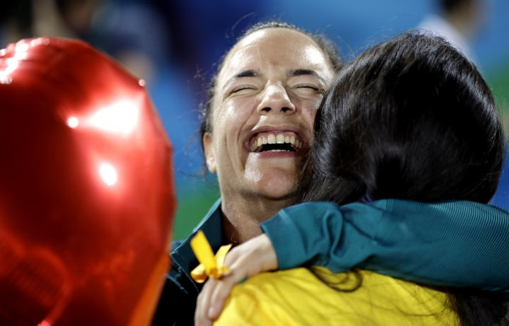 Brazil's Isadora Cerullo, shares a moment with her partner Marjorie Enya, after she was asked to marry her at the end of the medal ceremony for the women's rugby sevens match at the Summer Olympics in Rio de Janeiro, Brazil, Monday, Aug. 8, 2016. (AP Photo/Themba Hadebe)