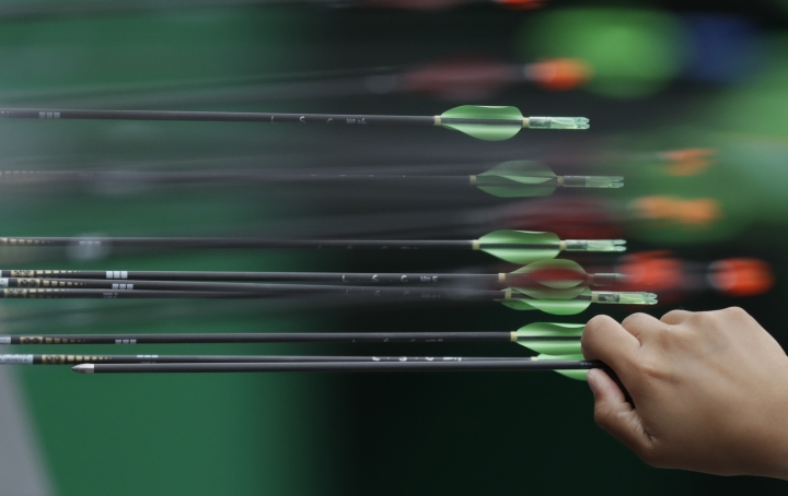 An archery athlete collects an arrow before the start of an elimination round of the individual archery competition at the Sambadrome venue during the 2016 Summer Olympics in Rio de Janeiro, Brazil, Wednesday, Aug. 10, 2016. (AP Photo/Alessandra Tarantino)