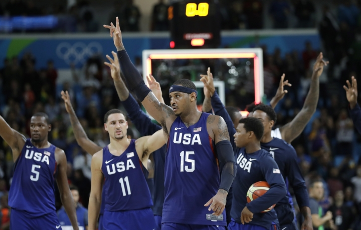 United States' Carmelo Anthony (15) and teammates walk off the court after their win over Australia in a men's basketball game at the 2016 Summer Olympics in Rio de Janeiro, Brazil, Wednesday, Aug. 10, 2016. (AP Photo/Eric Gay)