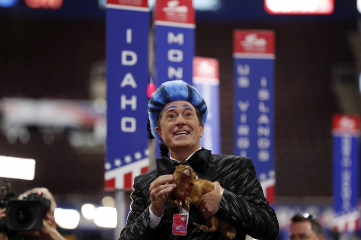 """FILE - In this July 17, 2016 file photo, talk show host Stephen Colbert performs on the floor of the Republican National Convention at Quicken Loans Arena during a taping of his program in Cleveland. Colbert, who capitalized on the political conventions with live airings of his late-night show, will do the same for the presidential and vice presidential debates. """"The Late Show with Stephen Colbert"""" will air live on CBS after the scheduled Sept. 26 and Oct. 19 debates between Hillary Clinton and Donald Trump and following the Tim Kaine-Mike Pence debate Oct. 4, the network said Wednesday, Aug. 10. (AP Photo/Carolyn Kaster, File)"""