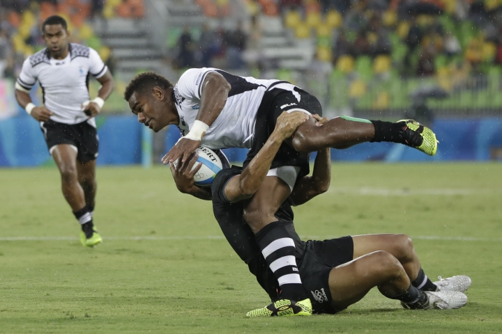 Fiji's Josua Tuisova, front, is tackled by New Zealand's Rieko Ioane, during the men's rugby sevens match at the Summer Olympics in Rio de Janeiro, Brazil, Wednesday, Aug. 10, 2016. (AP Photo/Themba Hadebe)