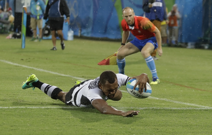 Fiji's Osea Kolinisau, scores a try during the men's rugby sevens match against New Zealand at the Summer Olympics in Rio de Janeiro, Brazil, Wednesday, Aug. 10, 2016. (AP Photo/Themba Hadebe)