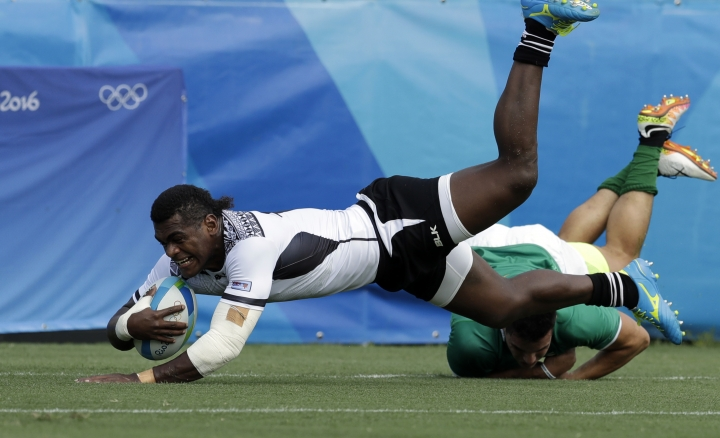 Fiji's Savenaca Rawaca, left, is tackled by Brazil's Daniel Sancery, during the men's rugby sevens match at the Summer Olympics in Rio de Janeiro, Brazil, Tuesday, Aug. 9, 2016. (AP Photo/Themba Hadebe)