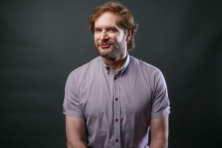 "FILE - In this Monday, Aug. 1, 2016 file photo, Bryan Fuller, showrunner/executive producer of the Starz series ""American Gods,"" poses for a portrait during the 2016 Television Critics Association Summer Press Tour at the Beverly Hilton in Beverly Hills, Calif. Following up a Comic-Con panel in July about ""Star Trek: Discovery,"" executive producer Fuller shared details about the 13-episode series' setting, characters and innovations at a Television Critics Association meeting Wednesday, Aug. 10. His disclosures included that the main character is female (human, yes; a captain, no); that the story will feature a gay character, and that there will more aliens. (Photo by Rich Fury/Invision/AP, File)"