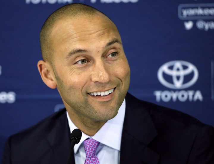 "FILE - In this Sept. 28, 2014, file photo, New York Yankees' Derek Jeter speaks to the media after the last baseball game of his career, against the Boston Red Sox, at Fenway Park in Boston. Jeter will help pay tribute to ""The Greatest"": Derek Jeter's publishing imprint is set to release ""Muhammad Ali Unfiltered."" Publication is set for October, according to a joint announcement given to The Associated Press on Thursday, Aug. 11, 2016 by Muhammad Ali Enterprises and Jeter Publishing.(AP Photo/Steven Senne, File)"