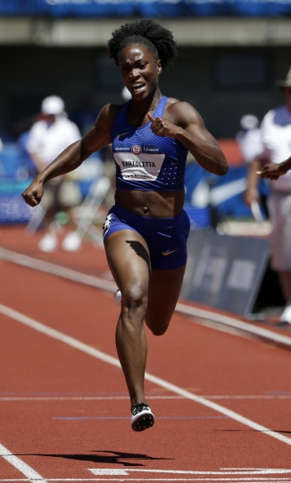 FILE - In this July 2, 2016 file photo, Tianna Bartoletta wins her heat during qualifying for women's 100-meter run at the U.S. Olympic Track and Field Trials. Bartoletta is going for gold at the 2016 Summer Olympics in both the 100 meters and the long jump. She's got her daily plans written on laminated cards that she brings with her to the track. (AP Photo/Marcio Jose Sanchez, File)