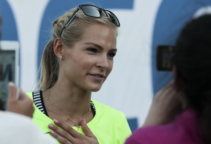 FILE - In this June 20, 2016 file photo, Russia's long jumper Darya Klishina speaks at the national track and field championship in Cheboksary, Russia. Klishina is the only athlete who met the standards when track's governing body, the IAAF, banned the Russian team from the 2016 Summer Olympics in June after an investigation revealed a culture of widespread, state-sponsored doping within the program. (AP Photo/Nikolai Alexandrov, File)