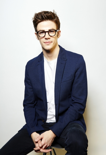 "FILE - In this Oct. 12, 2015 file photo, Grant Gustin poses for a portrait in New York. Gustin, who stars in The CW series, ""The Flash,"" will take part in a two episode musical crossover with ""Supergirl,"" starring Melissa Benoist. (Photo by Dan Hallman/Invision/AP, File)"