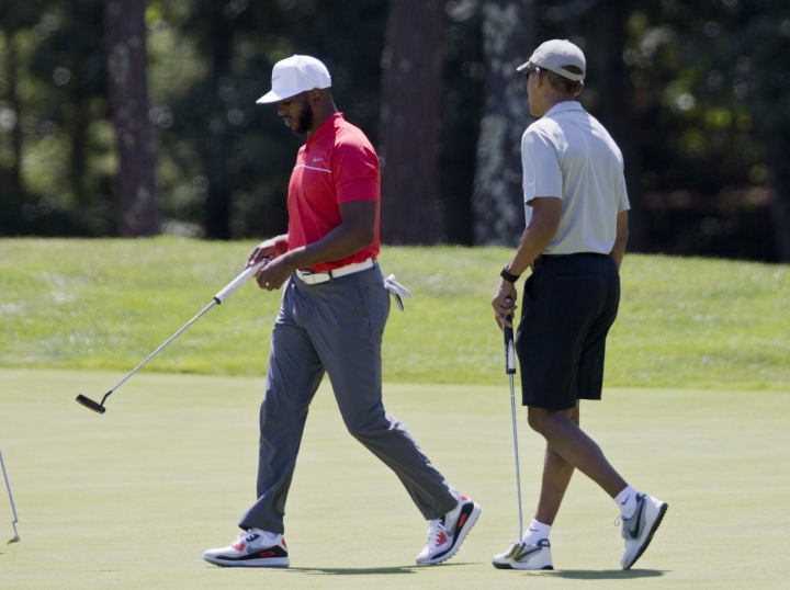 President Barack Obama and Los Angeles Clippers point guard Chris Paul walk on the first green during a round of golf at Farm Neck Golf Course in Oak Bluffs, Mass., on Martha's Vineyard, Sunday, Aug. 7, 2016. The president and his family are vacationing on the Massachusetts island of Martha's Vineyard. (AP Photo/Manuel Balce Ceneta)