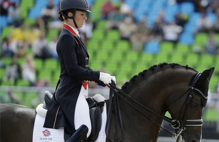 Britain's Charlotte Dujardin, riding Valegro, competes in the equestrian dressage competition at the 2016 Summer Olympics in Rio de Janeiro, Brazil, Thursday, Aug. 11, 2016. (AP Photo/John Locher)