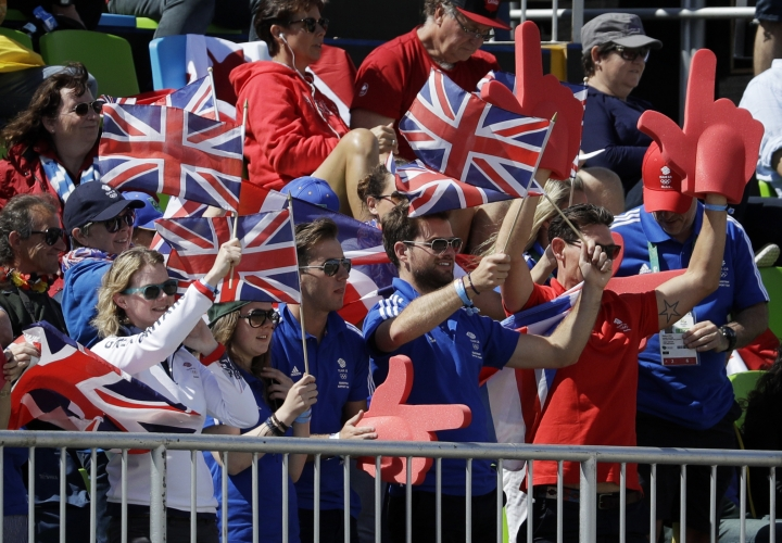 Fans cheer as Britain's Carl Hester, riding Nip Tuck, competes in the equestrian dressage competition at the 2016 Summer Olympics in Rio de Janeiro, Brazil, Thursday, Aug. 11, 2016. (AP Photo/John Locher)