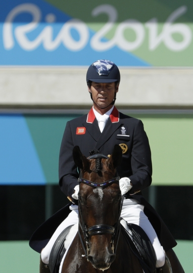 Britain's Carl Hester, riding Nip Tuck, competes in the equestrian dressage competition at the 2016 Summer Olympics in Rio de Janeiro, Brazil, Thursday, Aug. 11, 2016. (AP Photo/John Locher)