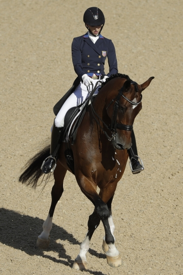 United States' Laura Graves, riding Verdades, competes in the equestrian dressage competition at the 2016 Summer Olympics in Rio de Janeiro, Brazil, Thursday, Aug. 11, 2016. (AP Photo/John Locher)