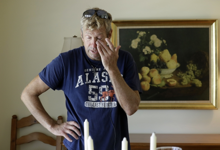 "Steve Knowlton wipes his eyes as he talks about his mother Mary Knowlton during an interview Wednesday, Aug. 10, 2016, in Punta Gorda, Fla. Police say an officer accidentally shot Mary to death during a citizen's academy ""shoot/don't shoot"" exercise Tuesday evening. (AP Photo/Chris O'Meara)"