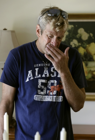 """Steve Knowlton wipes his face as he talks about his mother Mary Knowlton during an interview Wednesday, Aug. 10, 2016, in Punta Gorda, Fla. Police say an officer accidentally shot Mary to death during a citizen's academy """"shoot/don't shoot"""" exercise Tuesday evening. (AP Photo/Chris O'Meara)"""