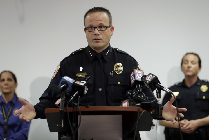 """Punta Gorda, Fla., Police Chief Tom Lewis gestures as he speaks to the media at the Public Safety Complex Wednesday, Aug. 10, 2016, in Punta Gorda, Fla. Police say an officer accidentally shot a woman to death during a citizen's academy """"shoot/don't shoot"""" exercise Tuesday evening. (AP Photo/Chris O'Meara)"""
