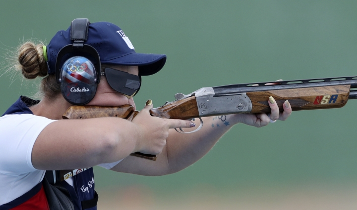 Corey Cogdell of the United States competes during the bronze medal match of the women's trap event at Olympic Shooting Center at the 2016 Summer Olympics in Rio de Janeiro, Brazil, Sunday, Aug. 7, 2016. Cogdell won the bronze medal. (AP Photo/Eugene Hoshiko)